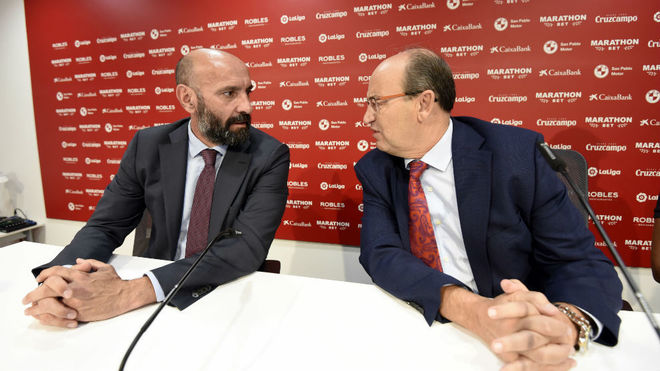 Monchi and Castro, at a press conference.