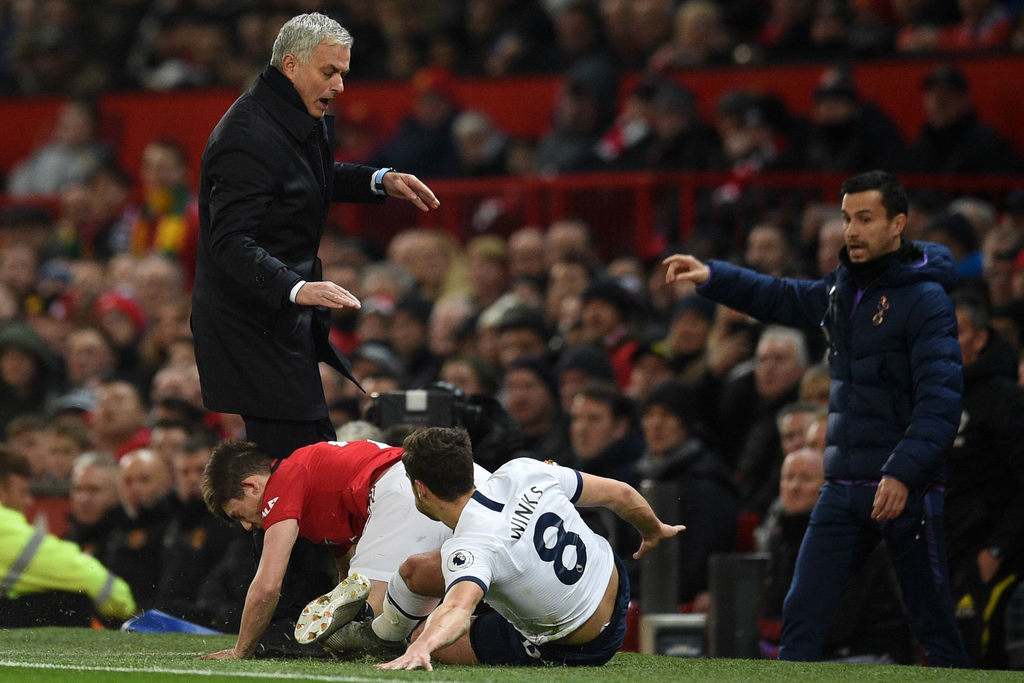 Manchester Uniteds Welsh midfielder Daniel James (2nd L) collides with Tottenham Hotspurs Portuguese head coach Jose <HIT>Mourinho</HIT> (L) on the touchline after a challenge with Tottenham Hotspurs English midfielder Harry Winks (R) during the English Premier League football match between Manchester United and Tottenham Hotspur at Old Trafford in Manchester, north west England, on December 4, 2019. (Photo by Oli SCARFF / AFP) / RESTRICTED TO EDITORIAL USE. No use with unauthorized audio, video, data, fixture lists, club/league logos or live services. Online in-match use limited to 120 images. An additional 40 images may be used in extra time. No video emulation. Social media in-match use limited to 120 images. An additional 40 images may be used in extra time. No use in betting publications, games or single club/league/player publications. /
