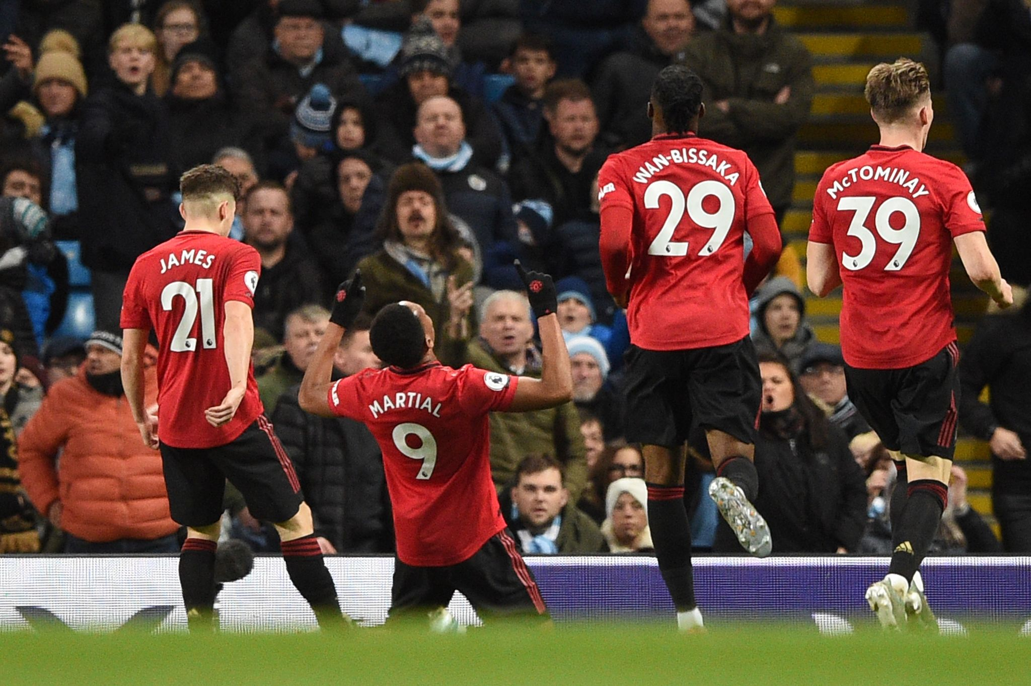 Manchester Uniteds French striker Anthony <HIT>Martial</HIT> (2L) celebrates scoring their second goal during the English Premier League football match between Manchester City and Manchester United at the Etihad Stadium in Manchester, north west England, on December 7, 2019. (Photo by Oli SCARFF / AFP) / RESTRICTED TO EDITORIAL USE. No use with unauthorized audio, video, data, fixture lists, club/league logos or live services. Online in-match use limited to 120 images. An additional 40 images may be used in extra time. No video emulation. Social media in-match use limited to 120 images. An additional 40 images may be used in extra time. No use in betting publications, games or single club/league/player publications. /