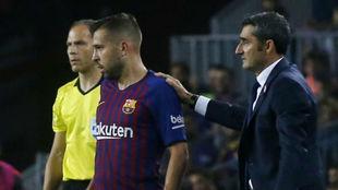 Alba y Valverde, en un partido.