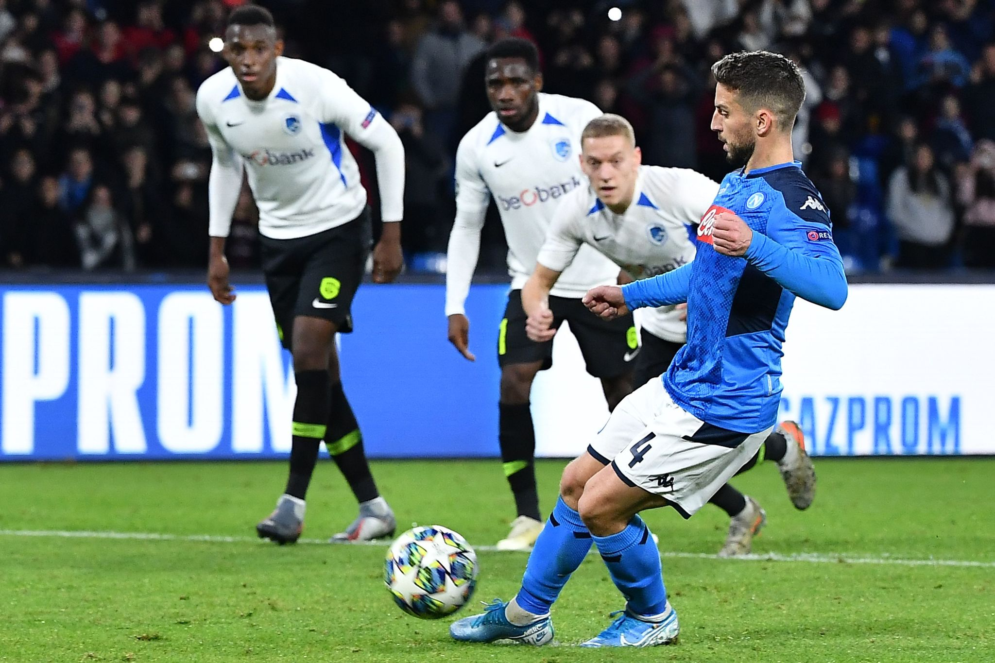 Napolis Belgian forward Dries <HIT>Mertens</HIT> (R) shoots to score a penalty during the UEFA Champions League Group E football match Napoli vs Genk on December 10, 2019 at the San Paolo stadium in Naples. (Photo by Tiziana FABI / AFP)