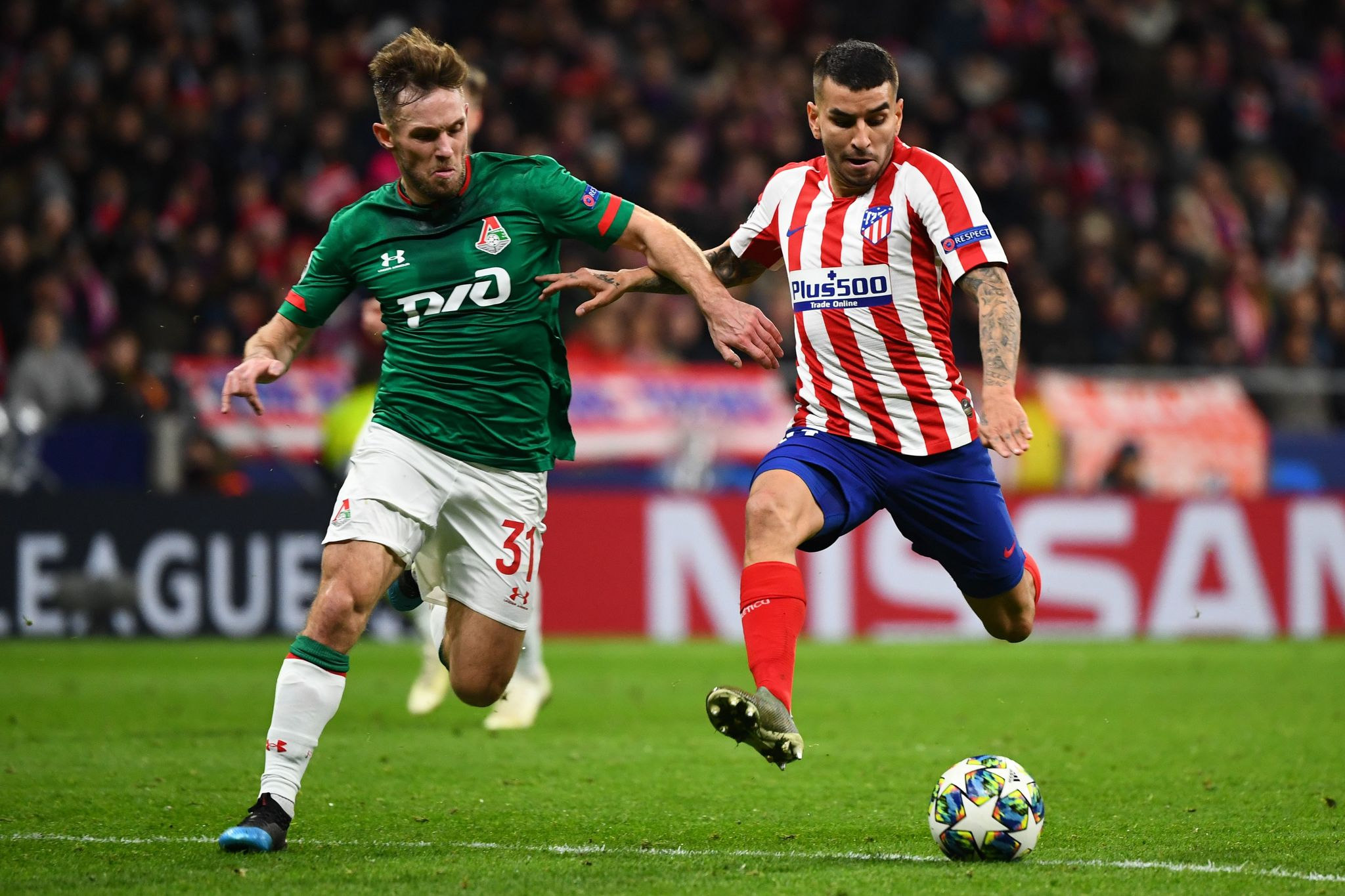 Lokomotiv Moscows Polish midfielder Maciej Rybus (L) vies with Atletico Madrids Argentine forward Angel <HIT>Correa</HIT> during the UEFA Champions League football match between Club Atletico de Madrid and Lokomotiv Moscow at the Wanda Metropolitano stadium in Madrid on December 11, 2019. (Photo by GABRIEL BOUYS / AFP)