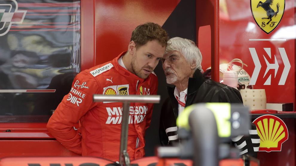 Sébastian Vettel y Bernie Ecclestone en el Gran Premio de Brasil.