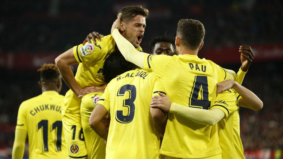 Villarreal players celebrate against Sevilla