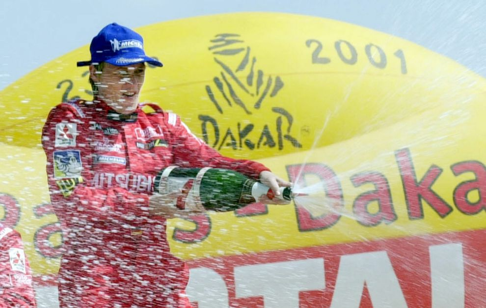 Kleinschmidt, celebrando su triunfo en el Dakar 2001.