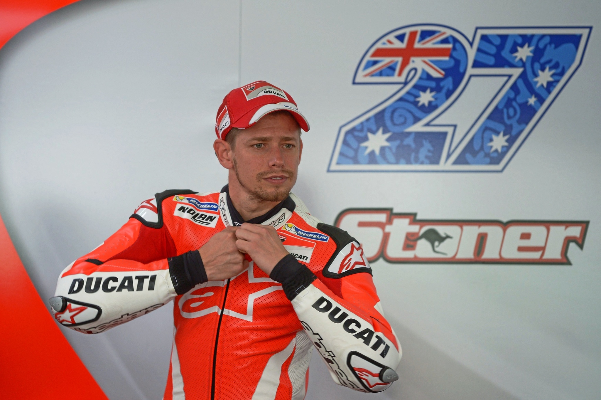 Ducati team test rider <HIT>Casey</HIT><HIT>Stoner</HIT> of Australia zips his racing suit before the second day of 2016 MotoGP pre-season test at the Sepang International circuit on February 2, 2016. AFP PHOTO / MOHD RASFAN