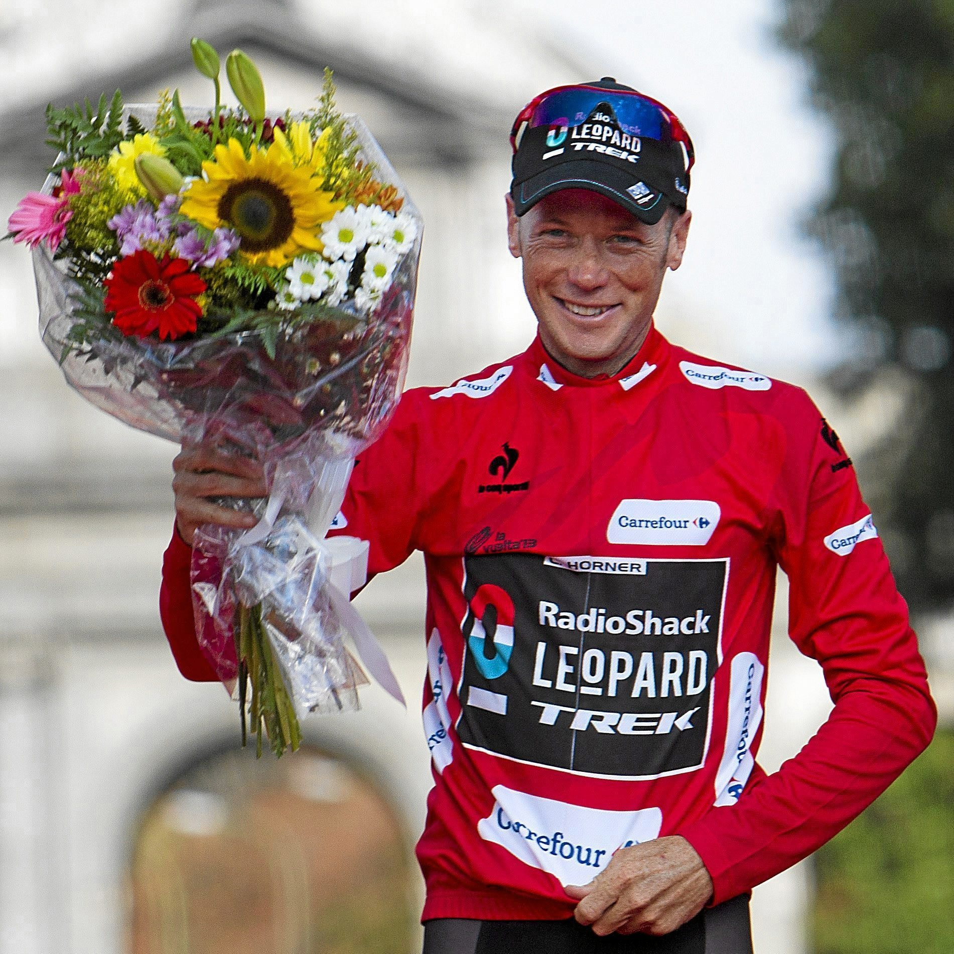 "RadioShacks US rider <HIT>Chris</HIT><HIT>Horner</HIT> celebrates on the podium after winning the ""Vuelta"" Tour of Spain in Madrid on September 15, 2013. <HIT>Chris</HIT><HIT>Horner</HIT> became the oldest ever winner of a cycling grand tour as the 41-year-old rubber stamped his victory in the Tour of Spain in Madrid today. AFP PHOTO/ JAIME REINA"