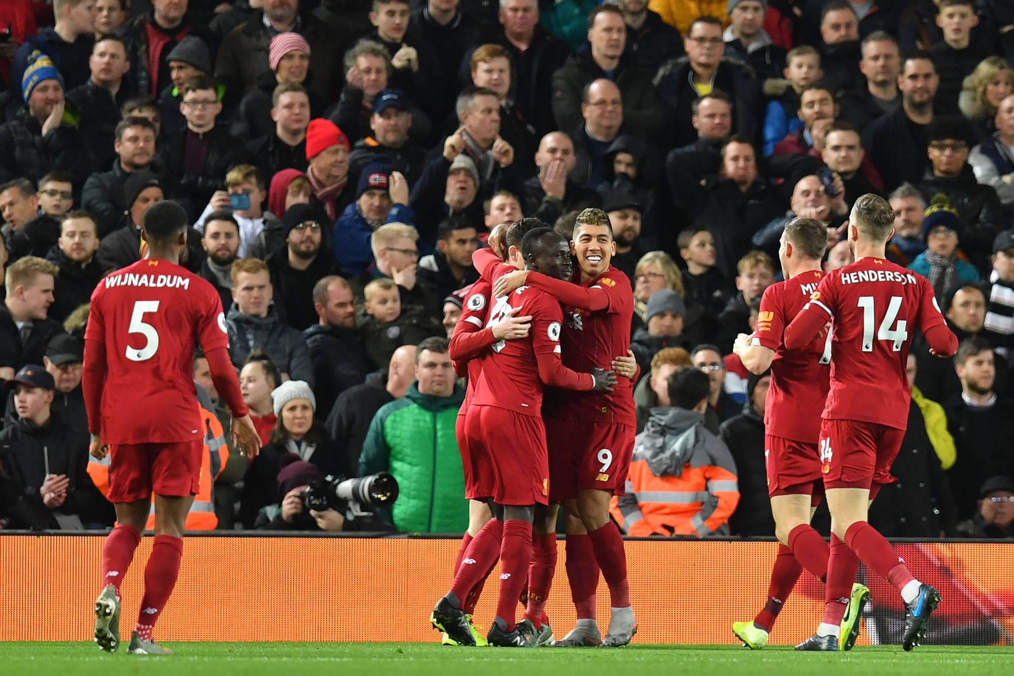 Liverpools Egyptian midfielder Mohamed <HIT>Salah</HIT> celebrates with teammates after scoring his teams first goal during the English Premier League football match between Liverpool and Sheffield United at Anfield in Liverpool, north west England on January 2, 2020. (Photo by Paul ELLIS / AFP) / RESTRICTED TO EDITORIAL USE. No use with unauthorized audio, video, data, fixture lists, club/league logos or live services. Online in-match use limited to 120 images. An additional 40 images may be used in extra time. No video emulation. Social media in-match use limited to 120 images. An additional 40 images may be used in extra time. No use in betting publications, games or single club/league/player publications. /
