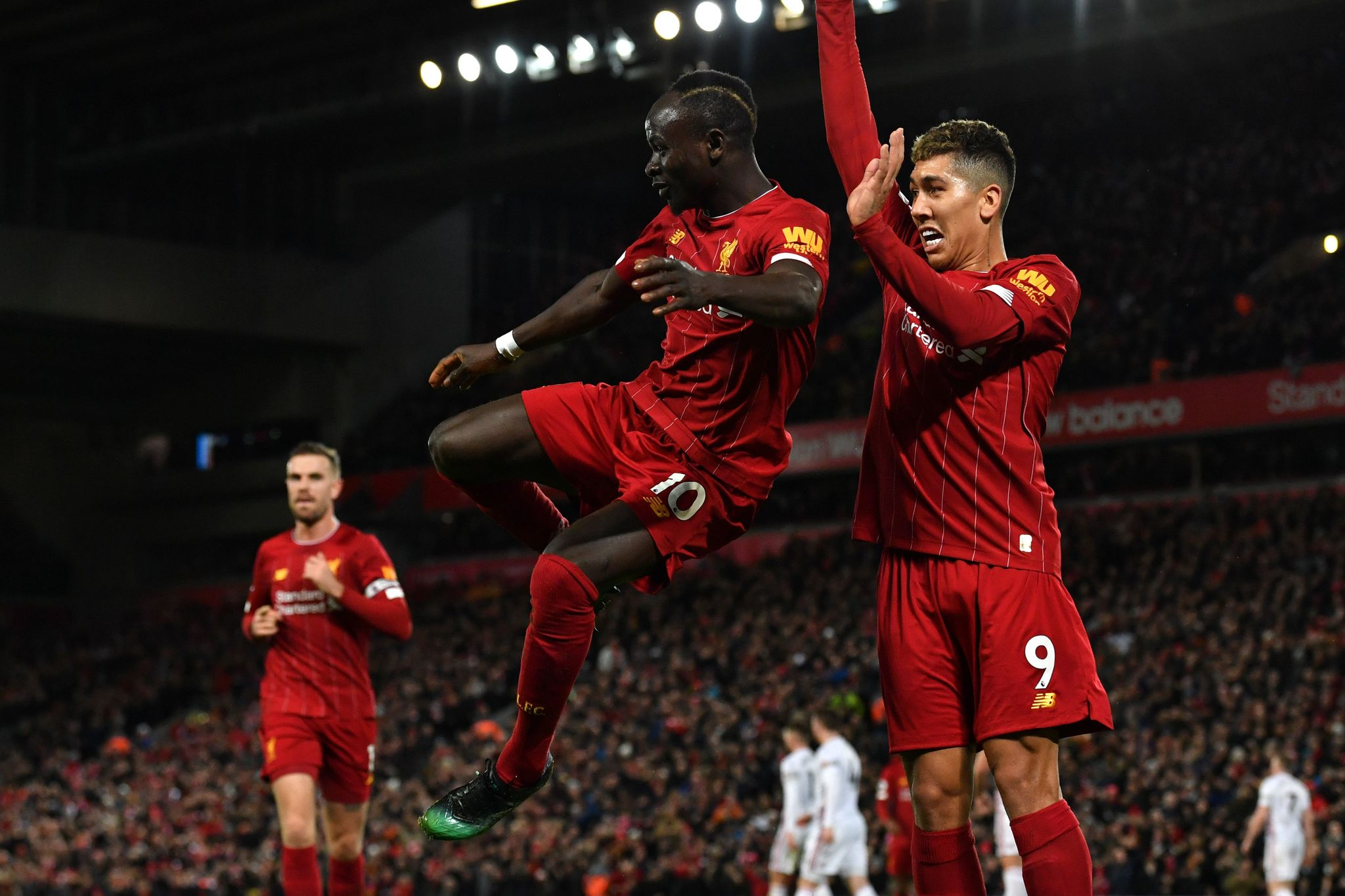 Liverpools Senegalese striker Sadio <HIT>Mane</HIT> (L) celebrates with Liverpools Brazilian midfielder Roberto Firmino after he scores his teams second goal during the English Premier League football match between Liverpool and Sheffield United at Anfield in Liverpool, north west England on January 2, 2020. (Photo by Paul ELLIS / AFP) / RESTRICTED TO EDITORIAL USE. No use with unauthorized audio, video, data, fixture lists, club/league logos or live services. Online in-match use limited to 120 images. An additional 40 images may be used in extra time. No video emulation. Social media in-match use limited to 120 images. An additional 40 images may be used in extra time. No use in betting publications, games or single club/league/player publications. /