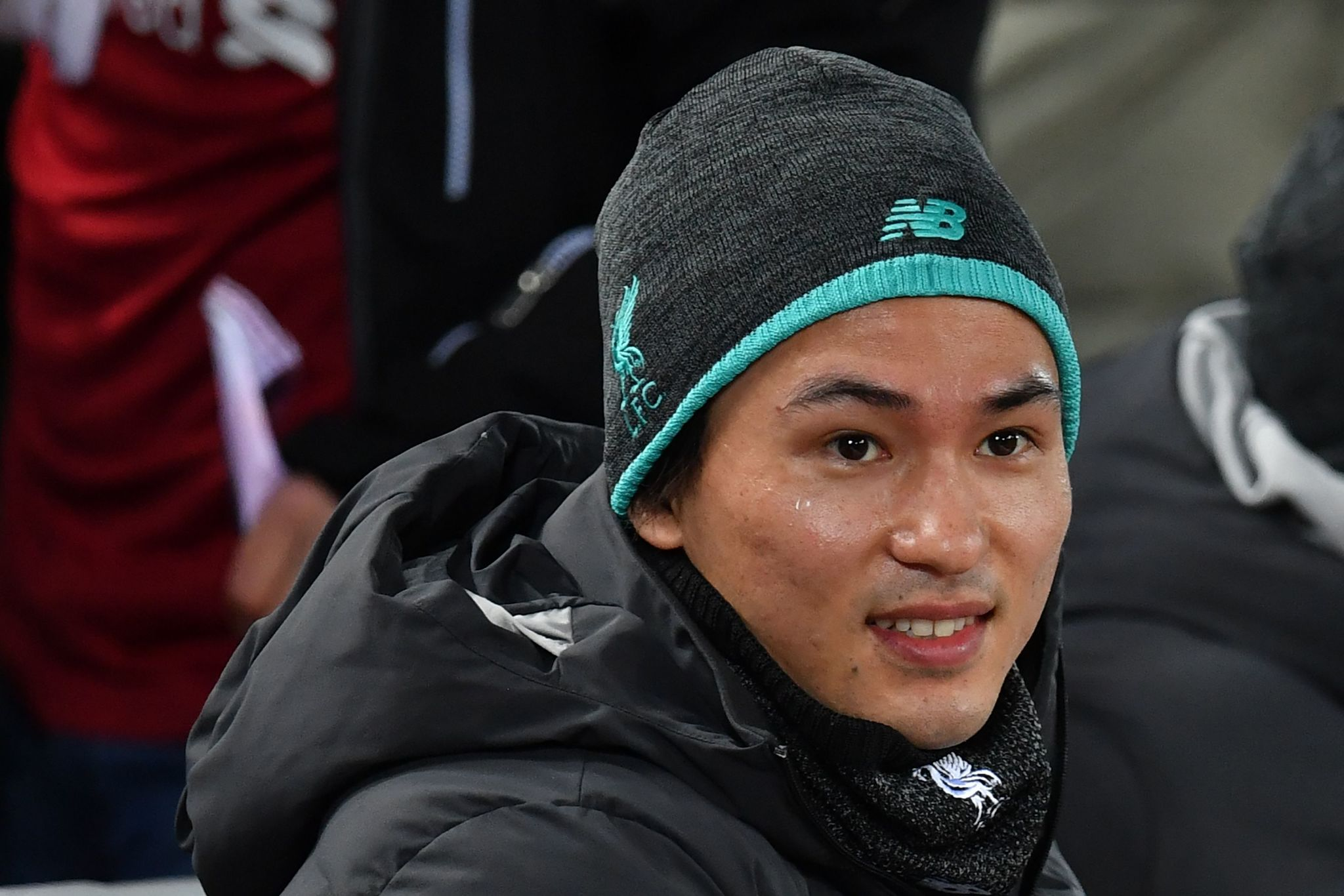 Liverpools new signing, Japanese midfielder Takumi <HIT>Minamino</HIT> looks on during the English Premier League football match between Liverpool and Sheffield United at Anfield in Liverpool, north west England on January 2, 2020. (Photo by Paul ELLIS / AFP) / RESTRICTED TO EDITORIAL USE. No use with unauthorized audio, video, data, fixture lists, club/league logos or live services. Online in-match use limited to 120 images. An additional 40 images may be used in extra time. No video emulation. Social media in-match use limited to 120 images. An additional 40 images may be used in extra time. No use in betting publications, games or single club/league/player publications. /