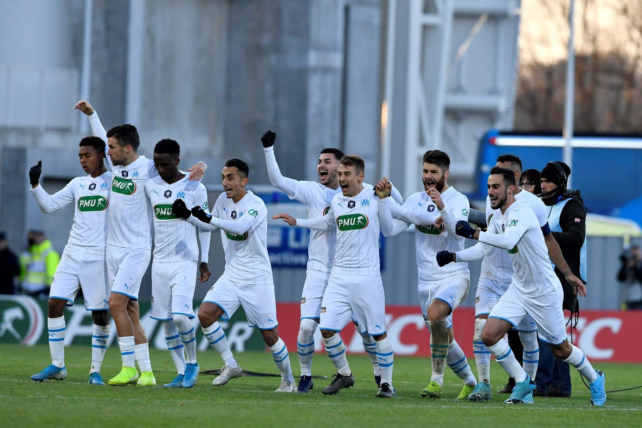 <HIT>Marseille</HIT>s players react after winning the French cup football match between Trelissac and <HIT>Marseille</HIT> on January 5, 2020, at the Beaublanc stadium in Limoges, central France. (Photo by NICOLAS TUCAT / AFP)