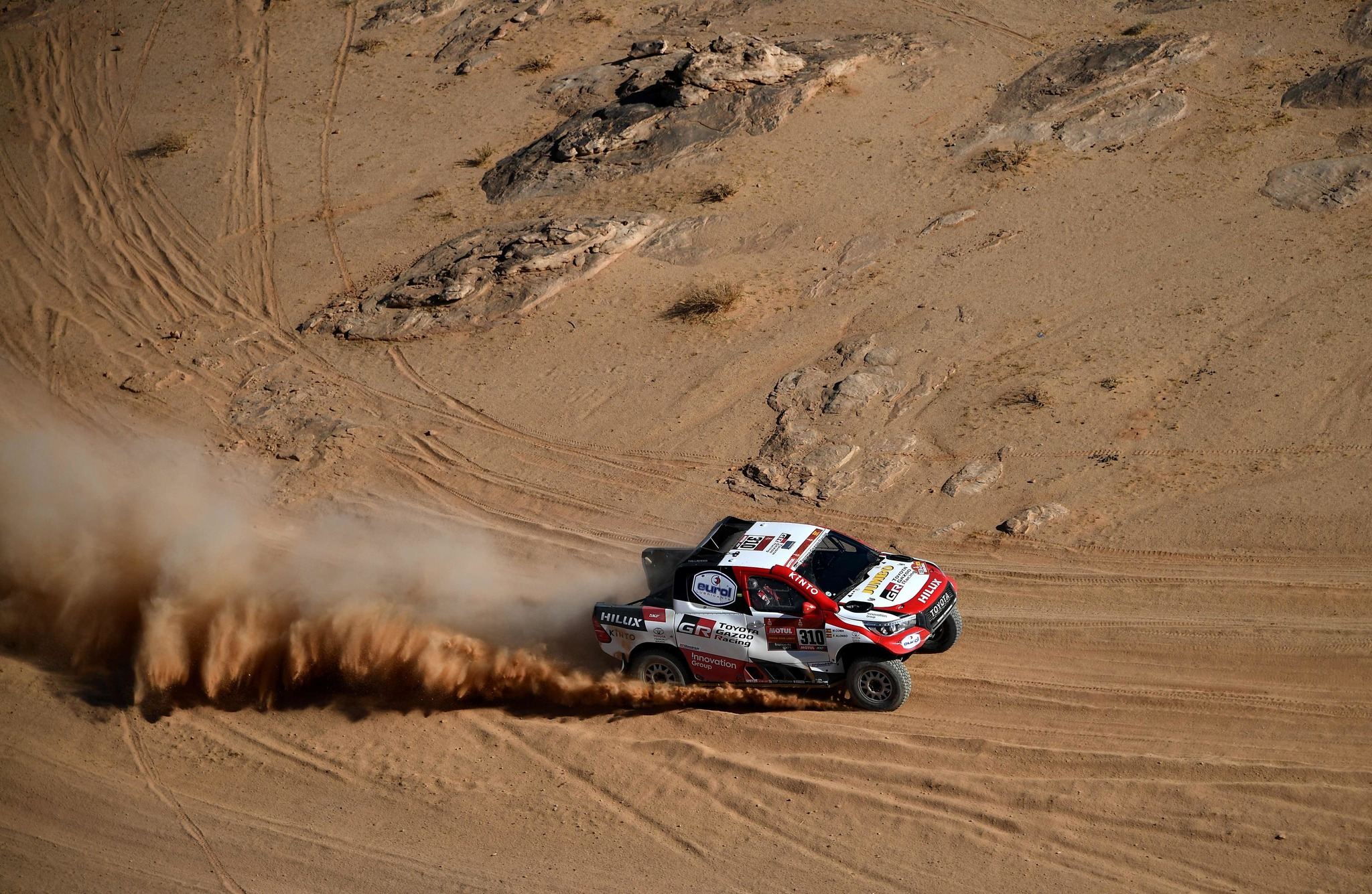 TOPSHOT - Toyotas Spanish driver Fernando <HIT>Alonso</HIT> and Spanish co-driver Marc Coma compete during the Stage 4 of the Dakar 2020 between Neom and Al-Ula, Saudi Arabia, on January 8, 2020. (Photo by FRANCK FIFE / AFP)
