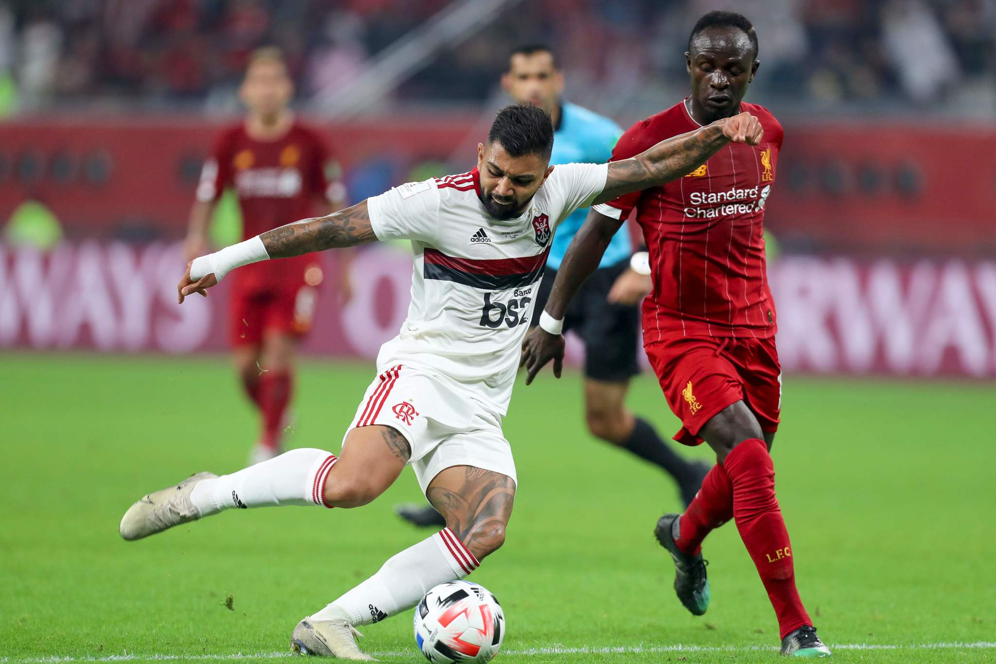 Flamengos forward Gabriel <HIT>Barbosa</HIT> (L) attempts a shot as he is marked by Liverpools Senegalese striker Sadio Mane during the 2019 FIFA Club World Cup Final football match between Englands Liverpool and Brazils Flamengo at the Khalifa International Stadium in the Qatari capital Doha on December 21, 2019. (Photo by KARIM JAAFAR / AFP)