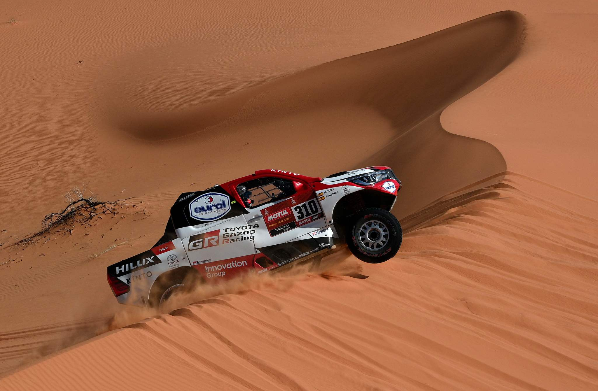 Toyotas driver Frenando <HIT>Alonso</HIT> of Spain and co-driver Marc Coma of Spain compete during the Stage 6 of the Dakar 2020 between Hail and Riyadh, Saudi Arabia, on January 10, 2020. (Photo by FRANCK FIFE / AFP)