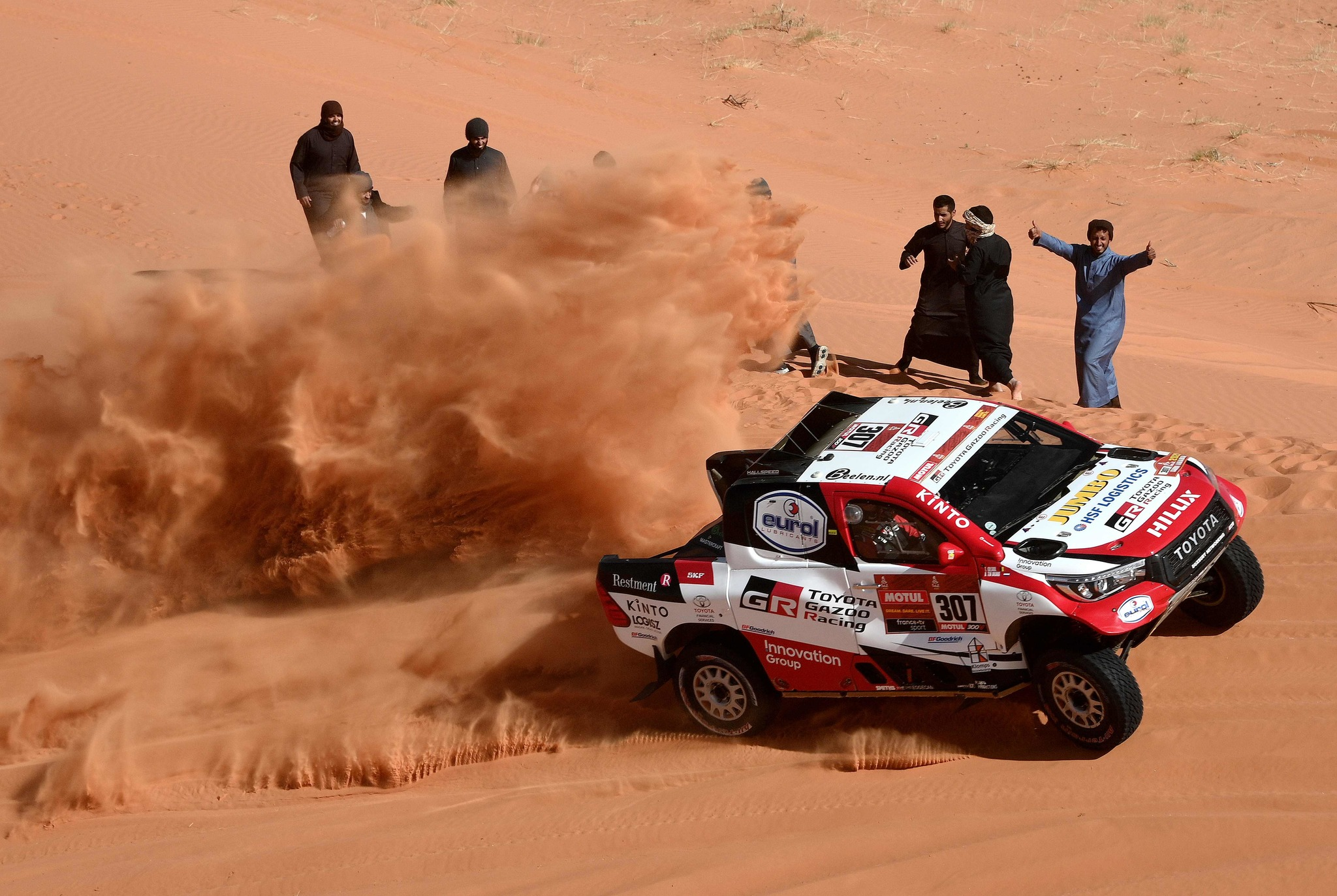 <HIT>Toyota</HIT>s driver Nasser Al-Attiyah of Qatar (R) and his co-driver Mathieu Baumel of France competes during the Stage 6 of the Dakar 2020 between Hail and Riyadh, Saudi Arabia, on January 10, 2020. (Photo by FRANCK FIFE / AFP)