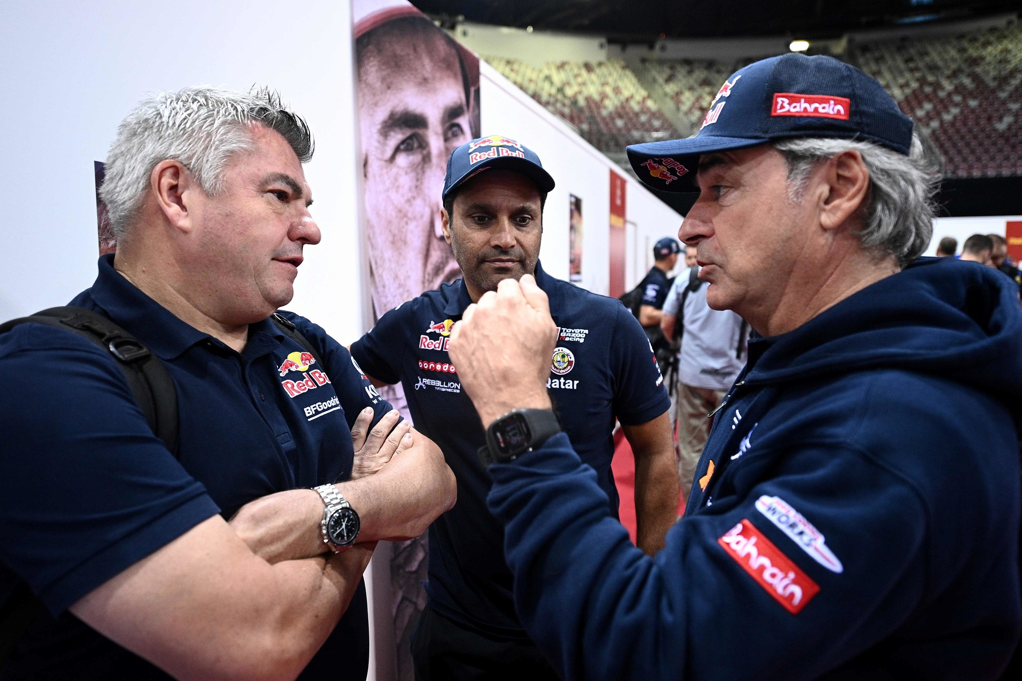 (from L) <HIT>Toyota</HIT>s team manager Jean Marc Fortin speaks with <HIT>Toyota</HIT>s driver Nasser Al-Attiyah of Qatar and <HIT>Mini</HIT>s drivers Carlos Sainz of Spain during a technical check-up in Jeddah, on January 4, 2020, ahead of the 2020 Dakar Rally, which this year will take place in Saudi Arabia from January 5 to 17, 2020. (Photo by FRANCK FIFE / AFP)