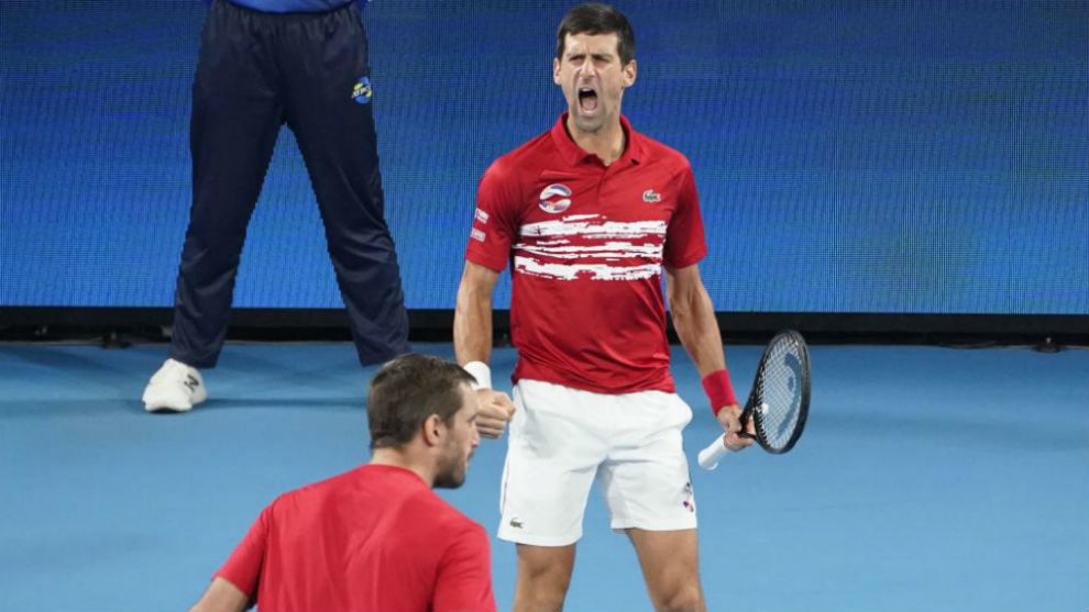 Djokovic celebra un punto en presencia de Troicki