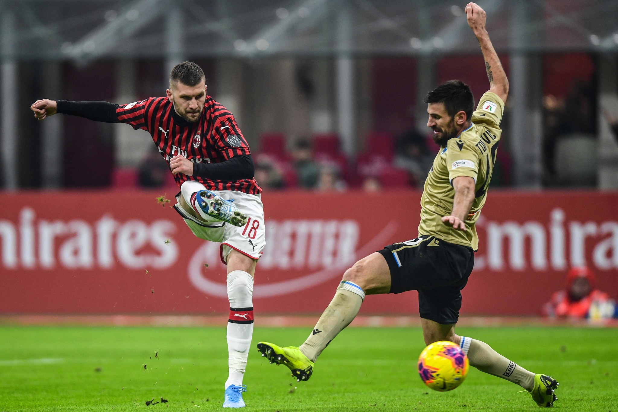 AC Milans Croatian forward Ante <HIT>Rebic</HIT> (L) shoots past Spals Serbian defender Nenad Tomovic during the Italian Cup (Coppa Italia) round of 16 football match AC Milan vs SPAL on January 15, 2020 at the San Siro stadium in Milan. (Photo by Miguel MEDINA / AFP)