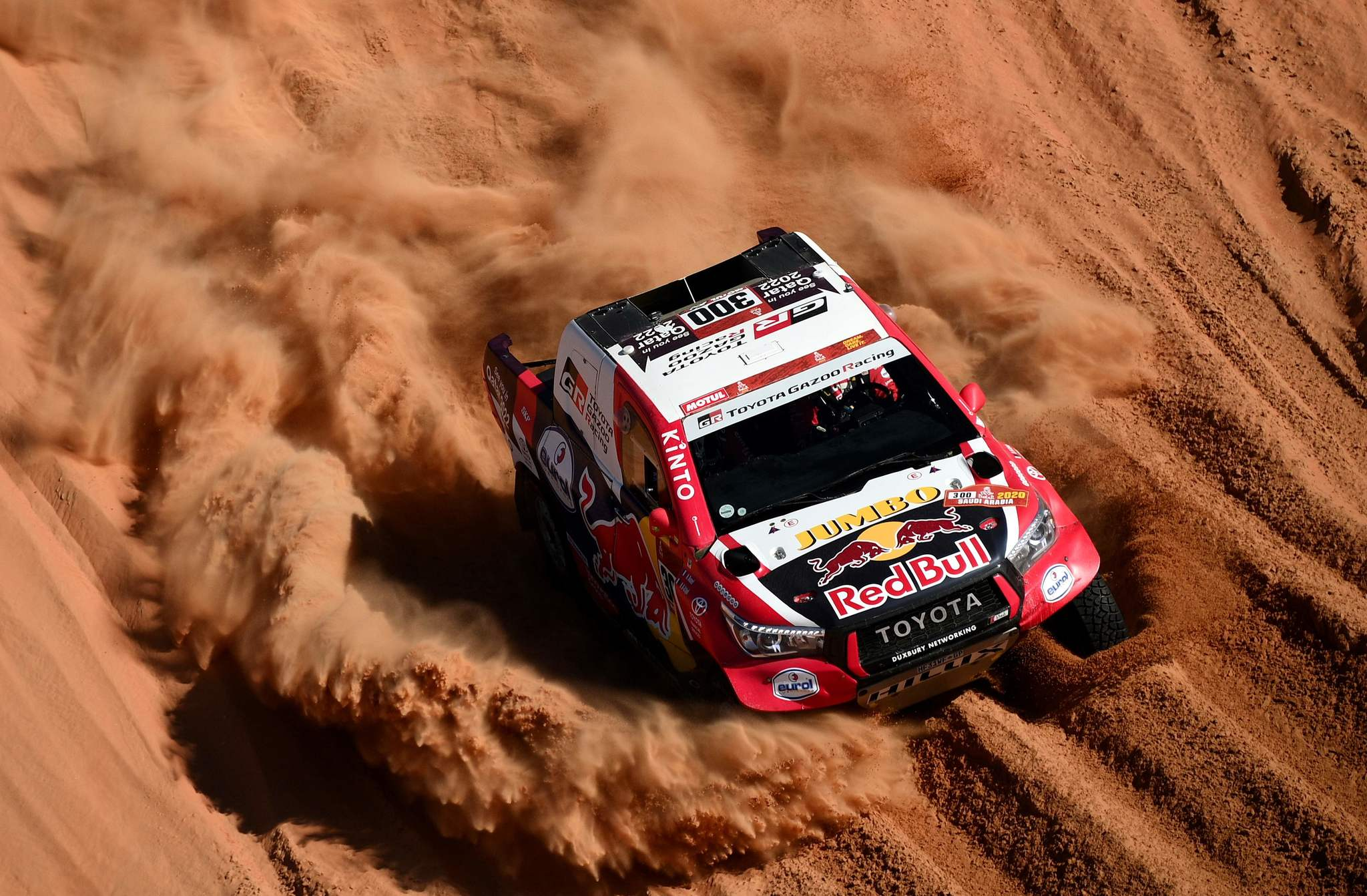TOPSHOT - Toyotas driver Nasser Al-<HIT>Attiyah</HIT> of Qatar and his co-driver Mathieu Baumel of France compete during the Stage 11 of the Dakar 2020 between Shubaytah and Haradh, Saudi Arabia, on January 16, 2020. (Photo by FRANCK FIFE / AFP)