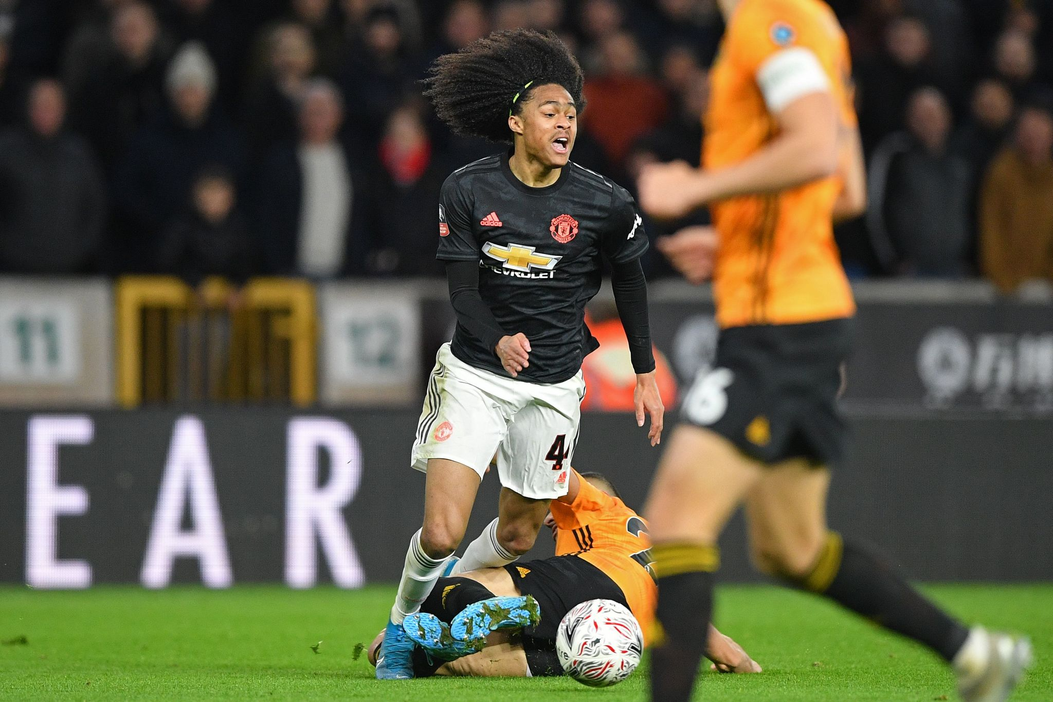 Wolverhampton Wanderers Moroccan midfielder Romain Saiss is booked for this foul on Manchester Uniteds Dutch midfielder <HIT>Tahith</HIT><HIT>Chong</HIT> (L) during the FA Cup third round football match between Wolverhampton Wanderers and Manchester United at the Molineux stadium in Wolverhampton, central England on January 4, 2020. (Photo by Justin TALLIS / AFP) / RESTRICTED TO EDITORIAL USE. No use with unauthorized audio, video, data, fixture lists, club/league logos or live services. Online in-match use limited to 120 images. An additional 40 images may be used in extra time. No video emulation. Social media in-match use limited to 120 images. An additional 40 images may be used in extra time. No use in betting publications, games or single club/league/player publications. /