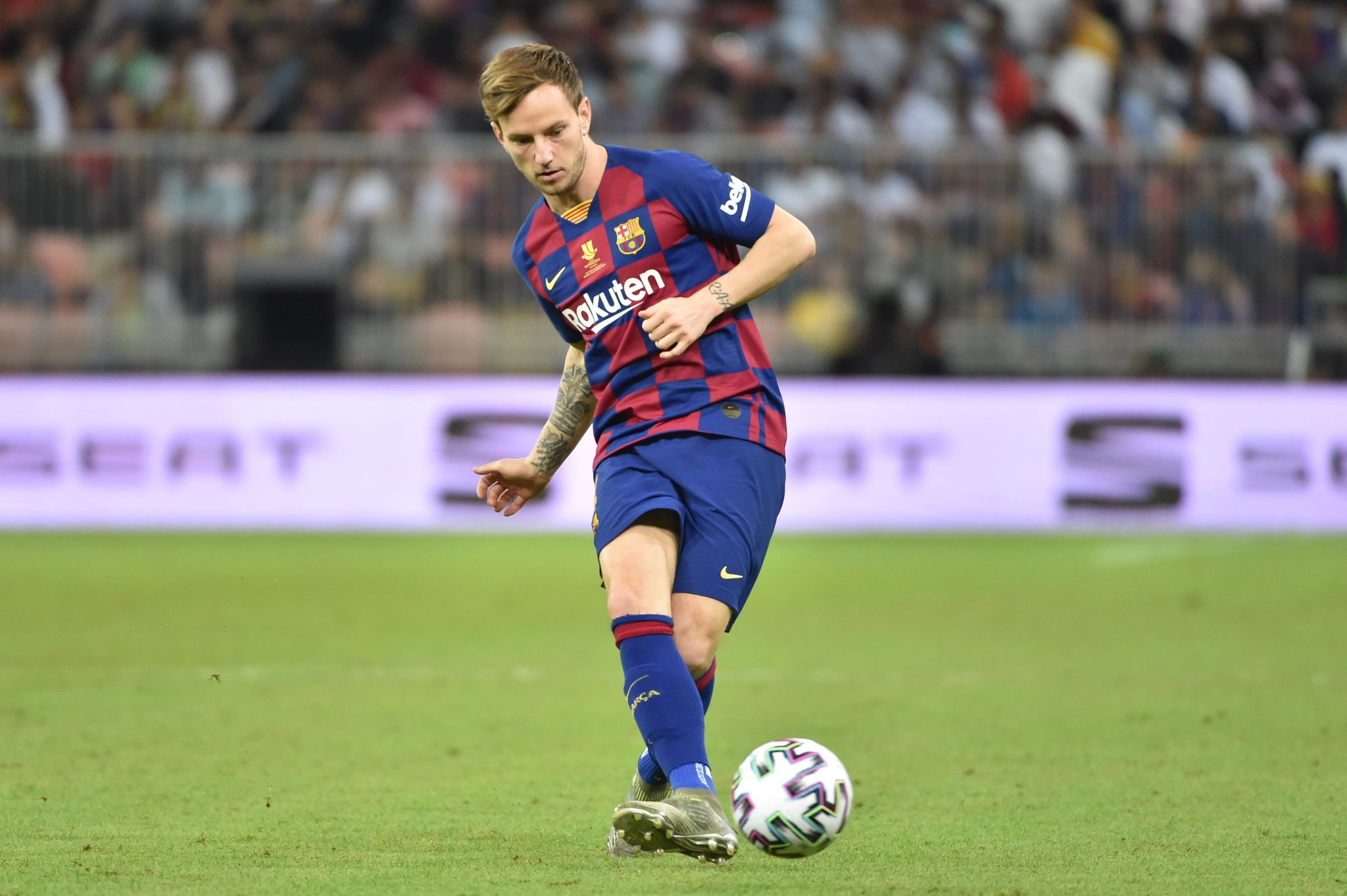 Barcelonas Croatian midfielder Ivan <HIT>Rakitic</HIT> passes the ball during the Spanish Super Cup semi final between Barcelona and Atletico Madrid on January 9, 2020, at the King Abdullah Sport City in the Saudi Arabian port city of Jeddah. - The winner will face Real Madrid in the final on January 12. (Photo by FAYEZ NURELDINE / AFP)