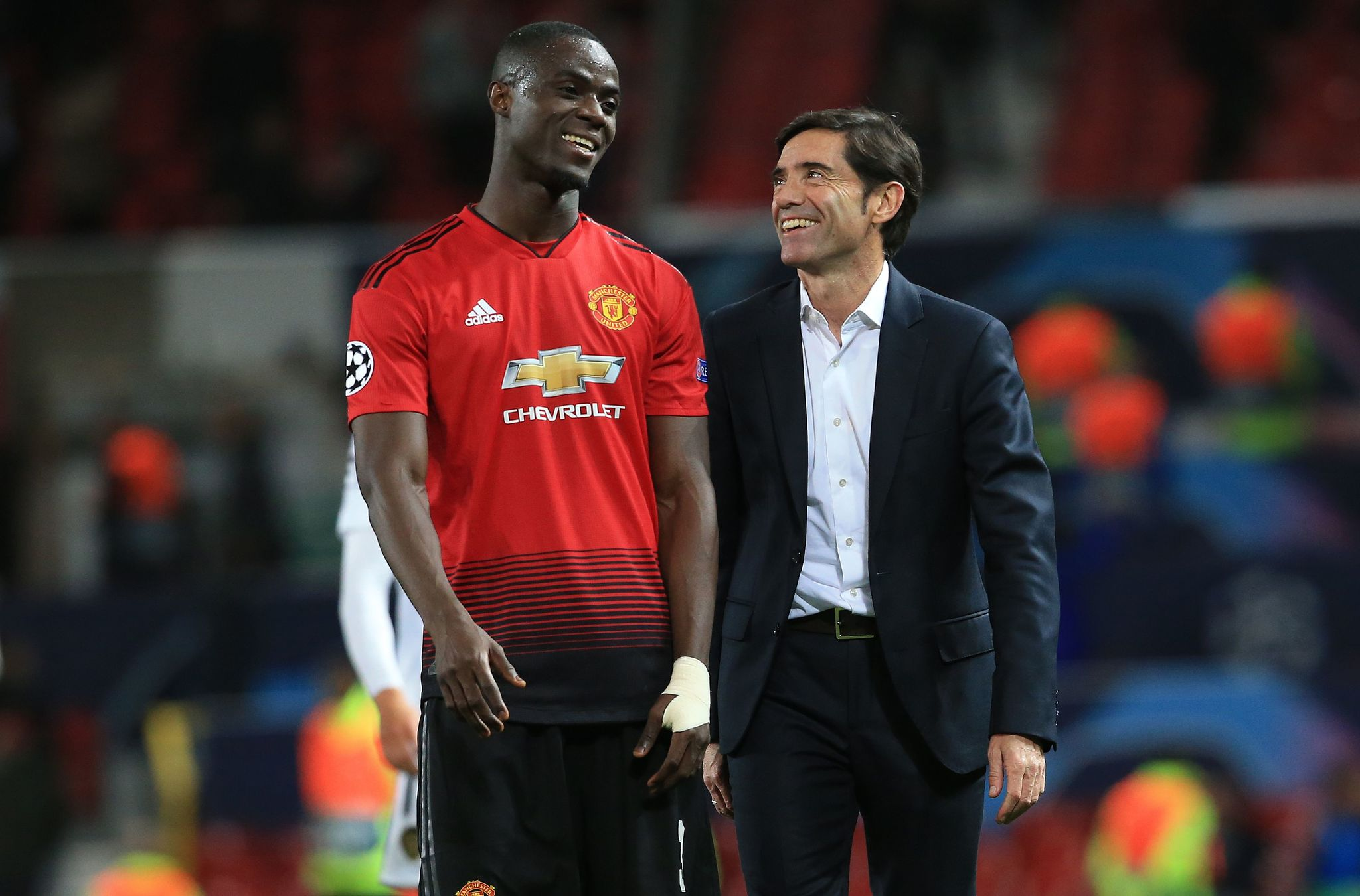 Valencias Spanish coach Marcelino Garcia Toral (R) and Manchester Uniteds Ivorian defender Eric <HIT>Bailly</HIT> react following the Champions League group H football match between Manchester United and Valencia at Old Trafford in Manchester, north west England, on October 2, 2018. - The match ended in a draw at 0-0. (Photo by Lindsey PARNABY / AFP)