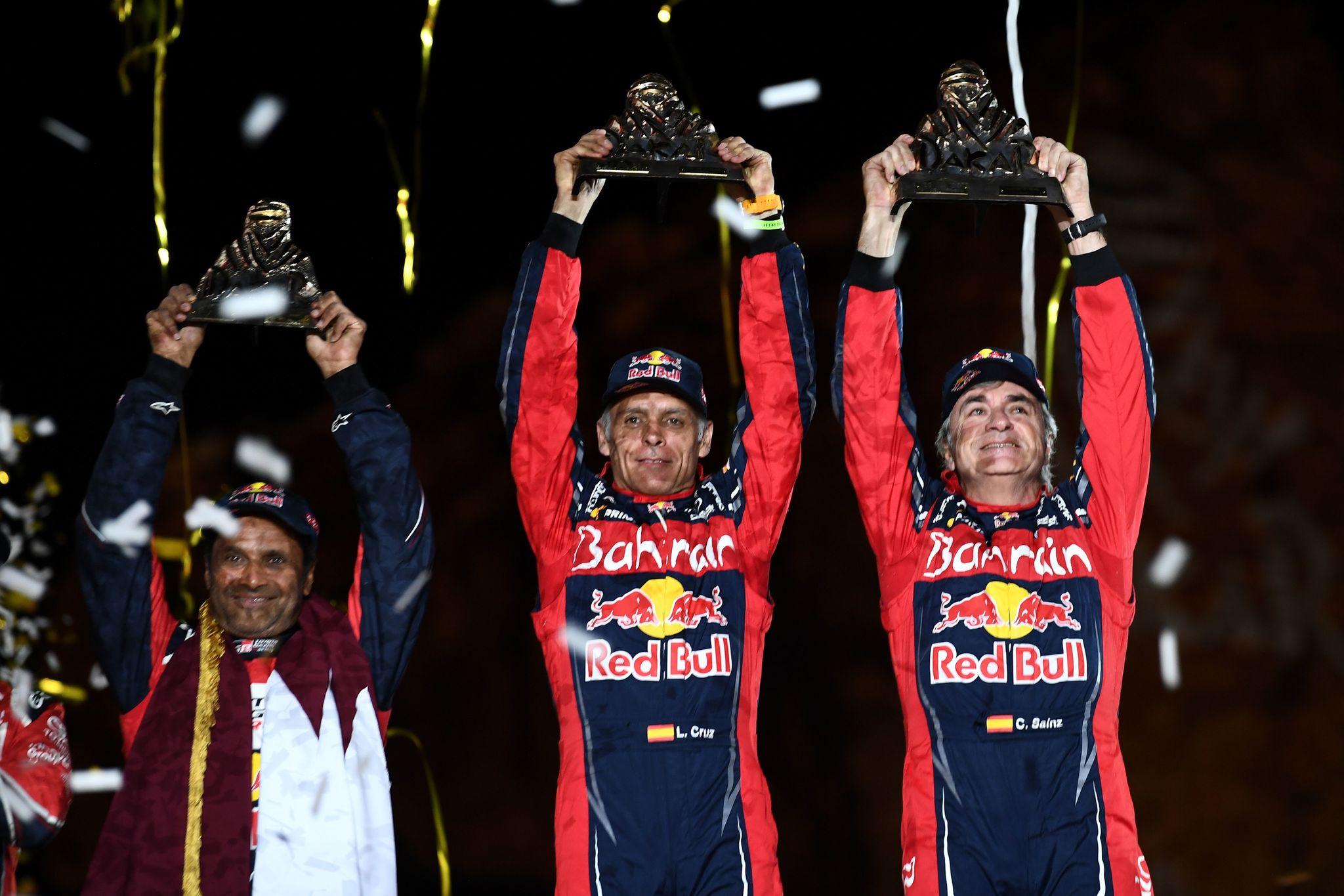 (From L) Qatars car driver Nasser al-Attiyah (placed second), Spanish Lucas Cruz and Carlos <HIT>Sainz</HIT> (first) celebrate on the finishing podium of the Dakar 2020 in Qiddiya on January 17, 2020 after the 12th and final stage between Haradh and Qiddiya. (Photo by FRANCK FIFE / AFP)