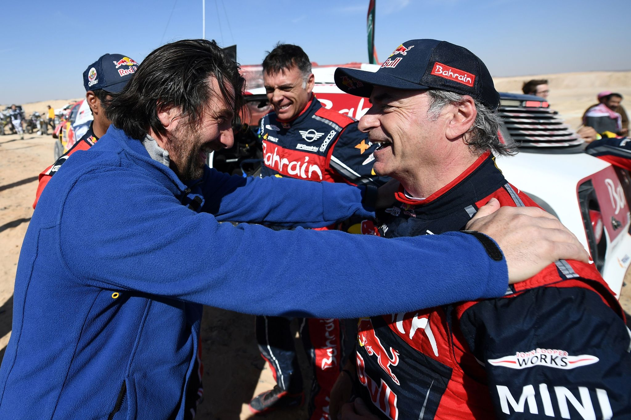 First-placed for the auto category JCW X-RAID Mini Team Spains driver Carlos Sainz (R), celebrates as he is congratulated by diector of the Dakar 2020 David <HIT>Castera</HIT> (L) on the finish area in Qiddiya at the end of the stage 12 of the Dakar 2020 between Haradh and Qiddiya, Saudi Arabia, on January 17, 2020. (Photo by FRANCK FIFE / AFP)