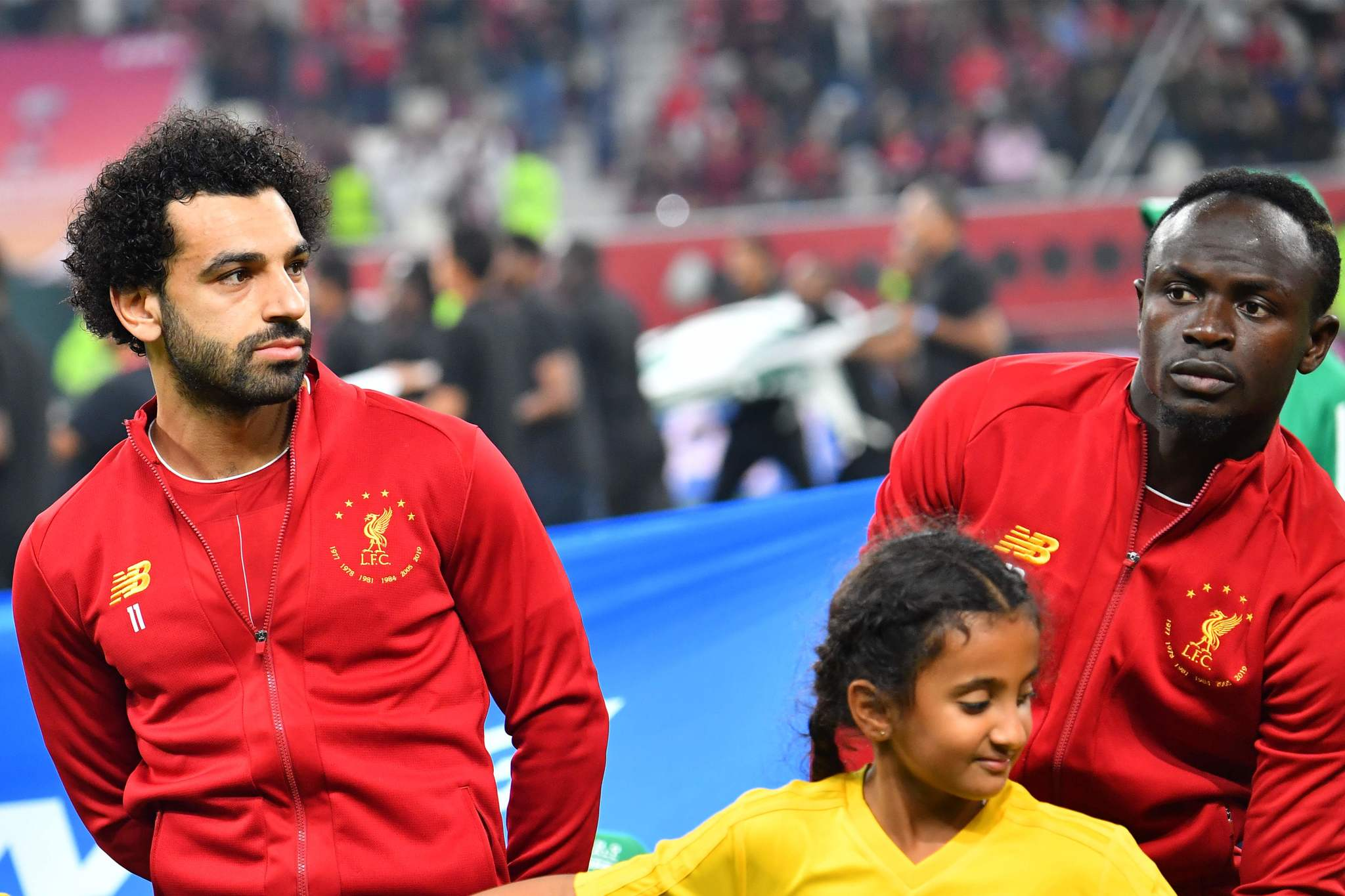 Liverpools Senegalese striker Sadio <HIT>Mane</HIT> (R) and Liverpools Egyptian midfielder Mohamed <HIT>Salah</HIT> look on ahead of the 2019 FIFA Club World Cup Final football match between Englands Liverpool and Brazils Flamengo at the Khalifa International Stadium in the Qatari capital Doha on December 21, 2019. (Photo by Giuseppe CACACE / AFP)