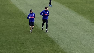 Koke and Diego Costa go through a light session