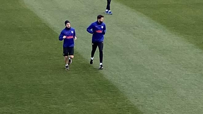 Koke y Diego Costa haciendo carrera continua.