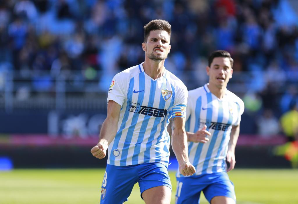 Adrián celebra con rabia el gol que abría el marcador en La Rosaleda