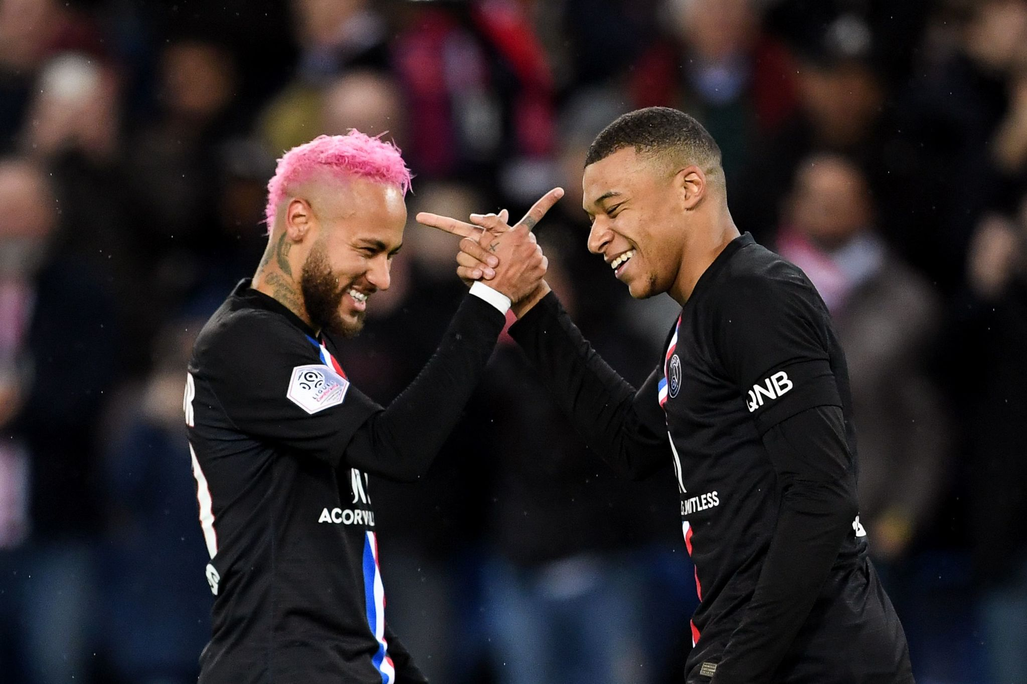 Paris Saint-Germains French forward Kylian <HIT>Mbappe</HIT> (R) is congratulated by Paris Saint-Germains Brazilian forward Neymar after scoring a goal during the French L1 football match between Paris Saint-Germain (PSG) and Montpellier Herault SC at the Parc des Princes stadium in Paris, on February 1, 2020. (Photo by MARTIN BUREAU / AFP)