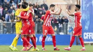 Los jugadores del Girona celebran el triunfo ante el Fuenlabrada.