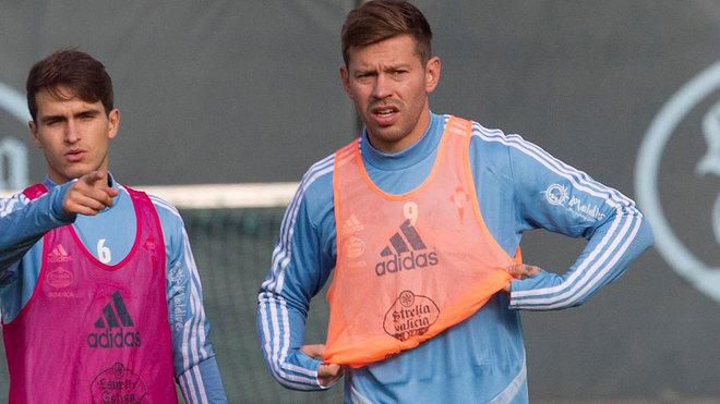Smolov, junto a Denis en un entrenamiento.