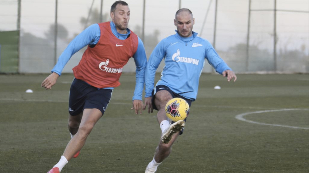 Ivanovic fends off Artem Dzyuba during Zenit's training session in...