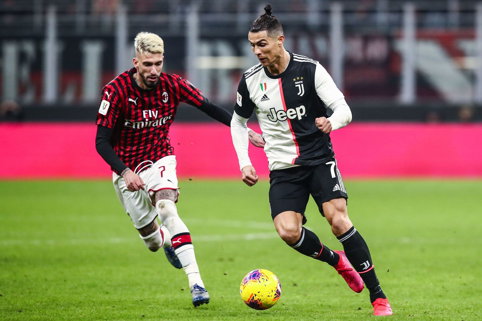 Juventus Portuguese forward lt;HIT gt;Cristiano lt;/HIT gt; Ronaldo (R) challenges AC Milans Spanish forward Samu Castillejo during the Italian Cup (Coppa Italia) semi-final first leg football match AC Milan vs Juventus Turin on February 13, 2020 at the San Siro stadium in Milan. (Photo by Isabella BONOTTO / AFP)