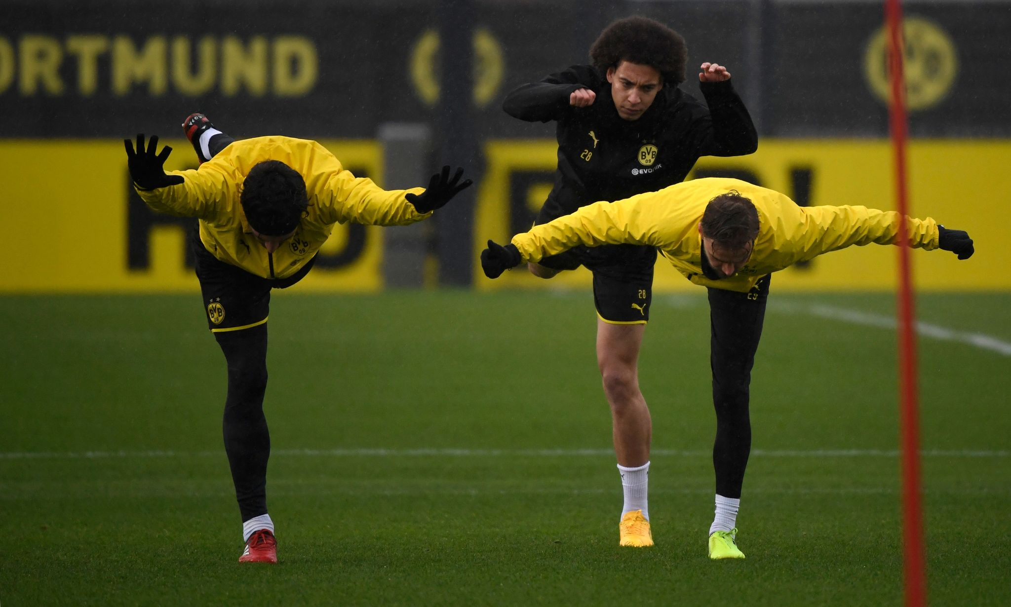 lt;HIT gt;Dortmund lt;/HIT gt;s German defender Mats Hummels, lt;HIT gt;Dortmund lt;/HIT gt;s Belgian midfielder Axel Witsel and lt;HIT gt;Dortmund lt;/HIT gt;s German defender Marcel Schmelzer warm up during a training session on the eve of the UEFA Champions League round of 16 first leg match BVB Borussia lt;HIT gt;Dortmund lt;/HIT gt; v Paris SG in lt;HIT gt;Dortmund lt;/HIT gt;, western Germany, on February 17, 2020. (Photo by INA FASSBENDER / AFP)
