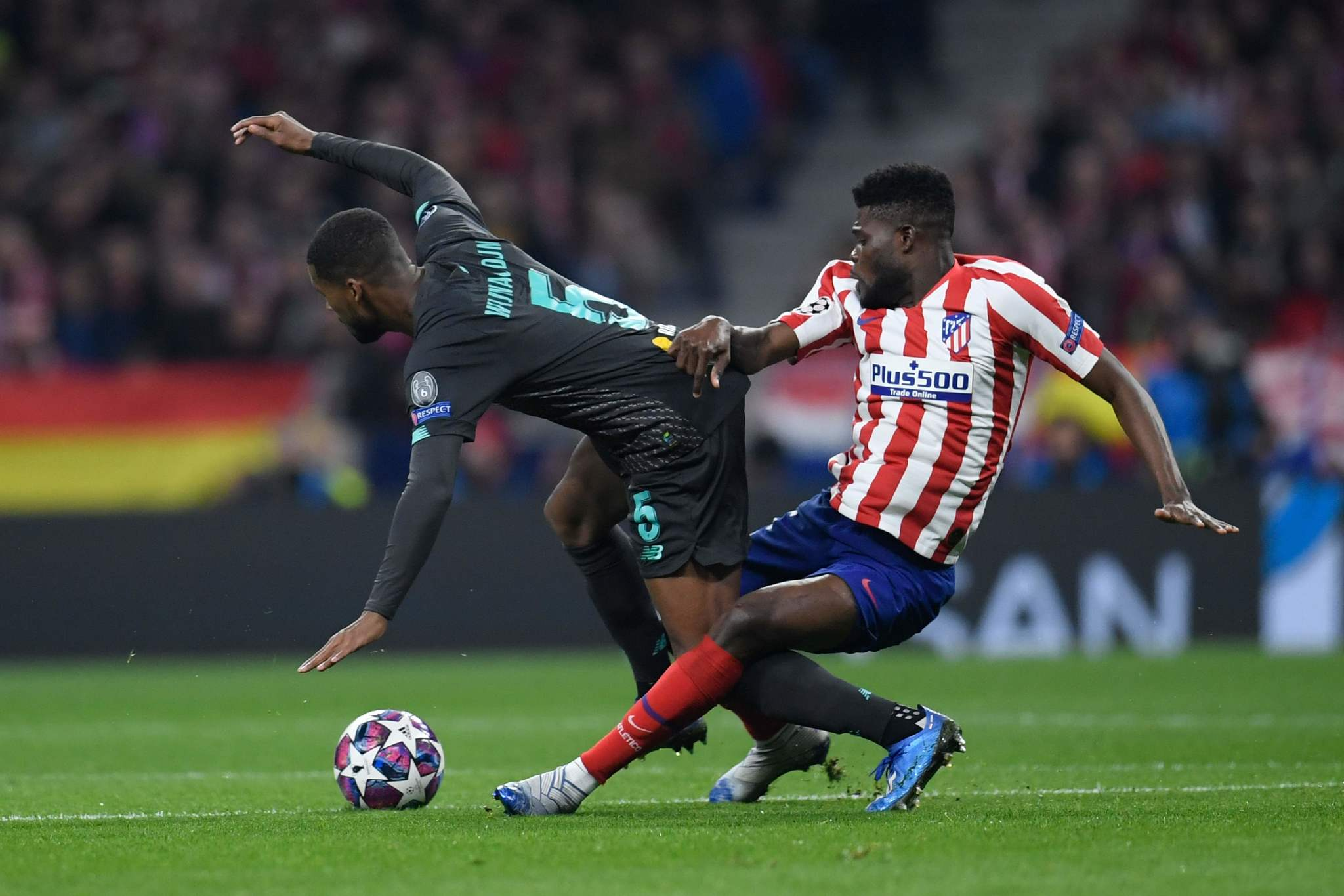 Atletico Madrids Ghanaian midfielder lt;HIT gt;Thomas lt;/HIT gt; Partey (R) challenges Liverpools Dutch midfielder Georginio Wijnaldum during the UEFA Champions League, round of 16, first leg football match between Club Atletico de Madrid and Liverpool FC at the Wanda Metropolitano stadium in Madrid on February 18, 2020. (Photo by OSCAR DEL POZO / AFP)