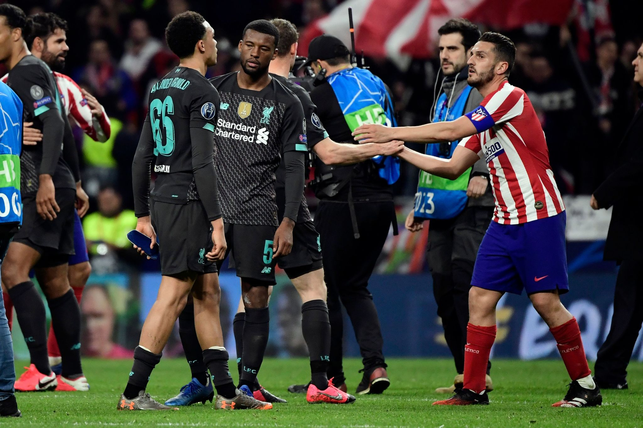 lt;HIT gt;Atletico lt;/HIT gt; Madrids Spanish midfielder Koke (R) is congratulated by Liverpools players at the end of the UEFA Champions League, round of 16, first leg football match between Club lt;HIT gt;Atletico lt;/HIT gt; de Madrid and Liverpool FC at the Wanda Metropolitano stadium in Madrid on February 18, 2020. (Photo by JAVIER SORIANO / AFP)