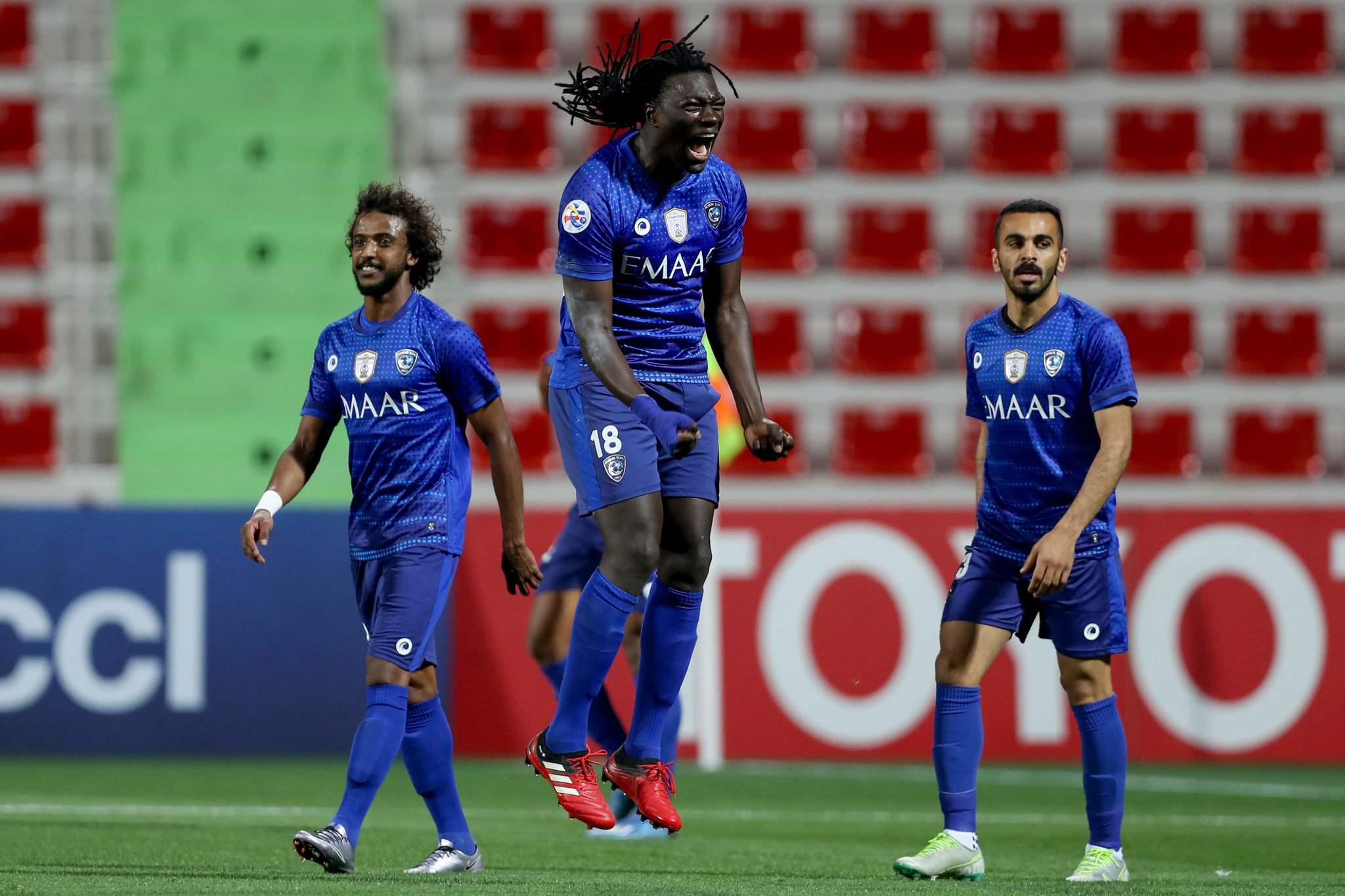 Hilals forward Bafetimbi lt;HIT gt;Gomis lt;/HIT gt; (C) celebrates his goal with teammates during the AFC Champions League group B football match between UAEs Shabab al-Ahli and Saudis al-Hilal at the Rashid Stadium in Dubai on February 17, 2020. (Photo by - / AFP)