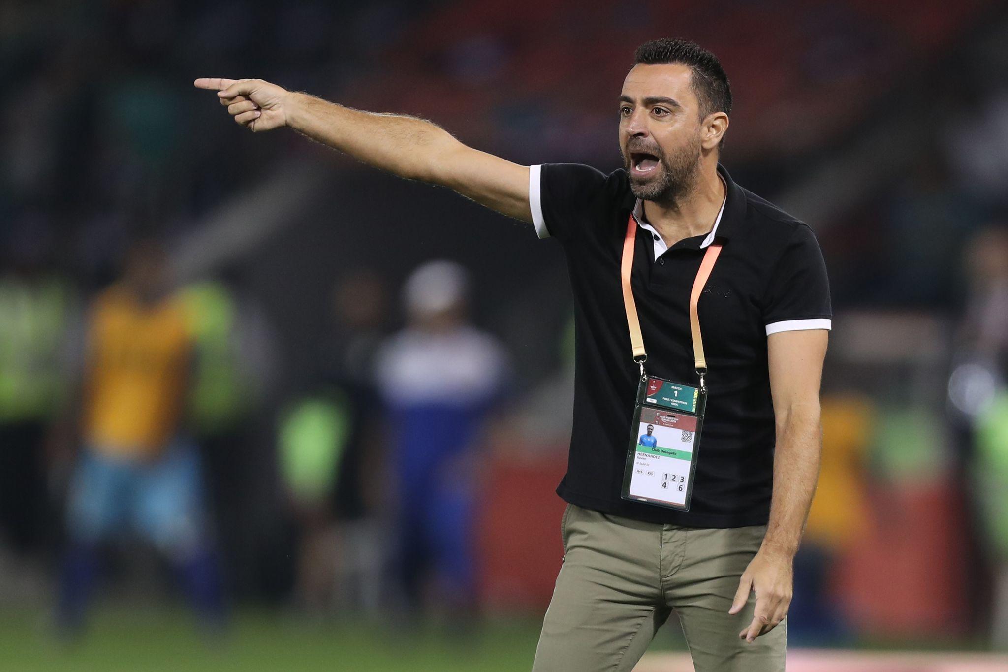 Sadds coach lt;HIT gt;Xavi lt;/HIT gt; reacts during the 2019 FIFA Club World Cup football match between Qatars Al-Sadd and New Caledonias Hienghene Sport at the Jassim Bin Hamad Stadium in the Qatari capital Doha on December 11, 2019. (Photo by KARIM JAAFAR / AFP)