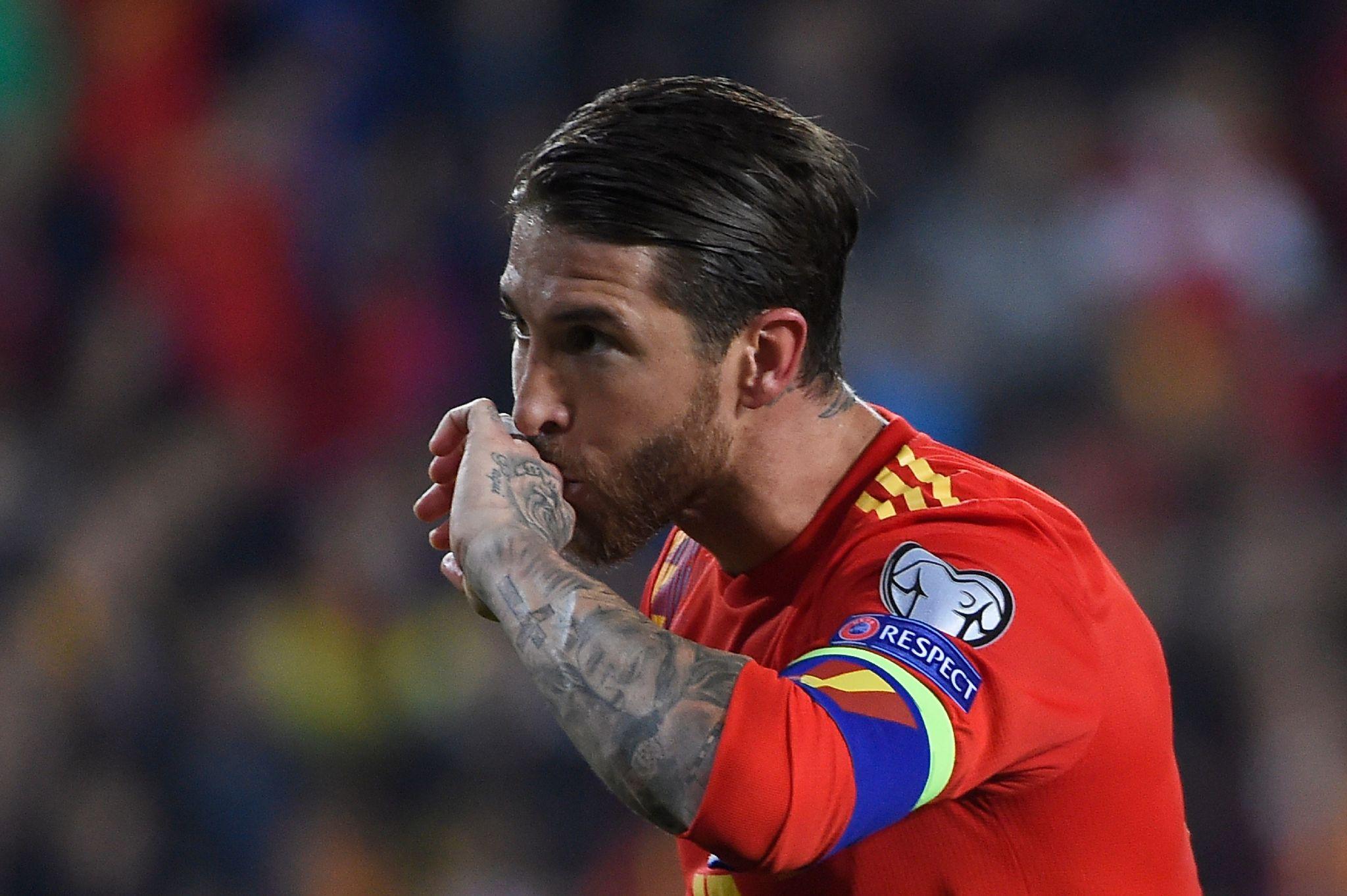 lt;HIT gt;Spain lt;/HIT gt;s defender lt;HIT gt;Sergio lt;/HIT gt; lt;HIT gt;Ramos lt;/HIT gt; celebrates after scoring a goal during the Euro 2020 group F qualifying football match between lt;HIT gt;Spain lt;/HIT gt; and Norway at the Mestalla Stadium in Valencia on March 23, 2019. (Photo by JOSE JORDAN / AFP)