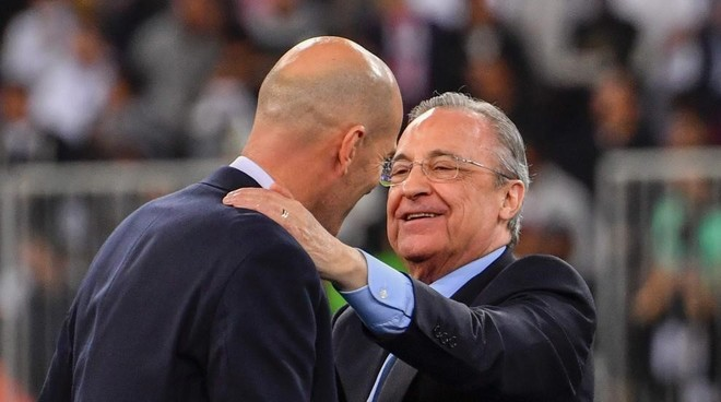Florentino Perez embraces Zinedine Zidane after Supercopa de Espana...