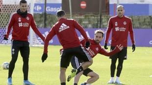 Míchel, Moyanbo, Sergi Guardiola y Sandro en un entrenamiento del...