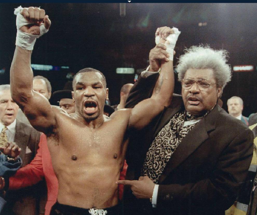Mike Tyson con el promotor Don King en 2008