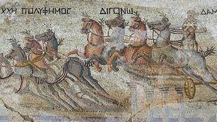 Mosaico romano que representa una carrera de cuádrigas.