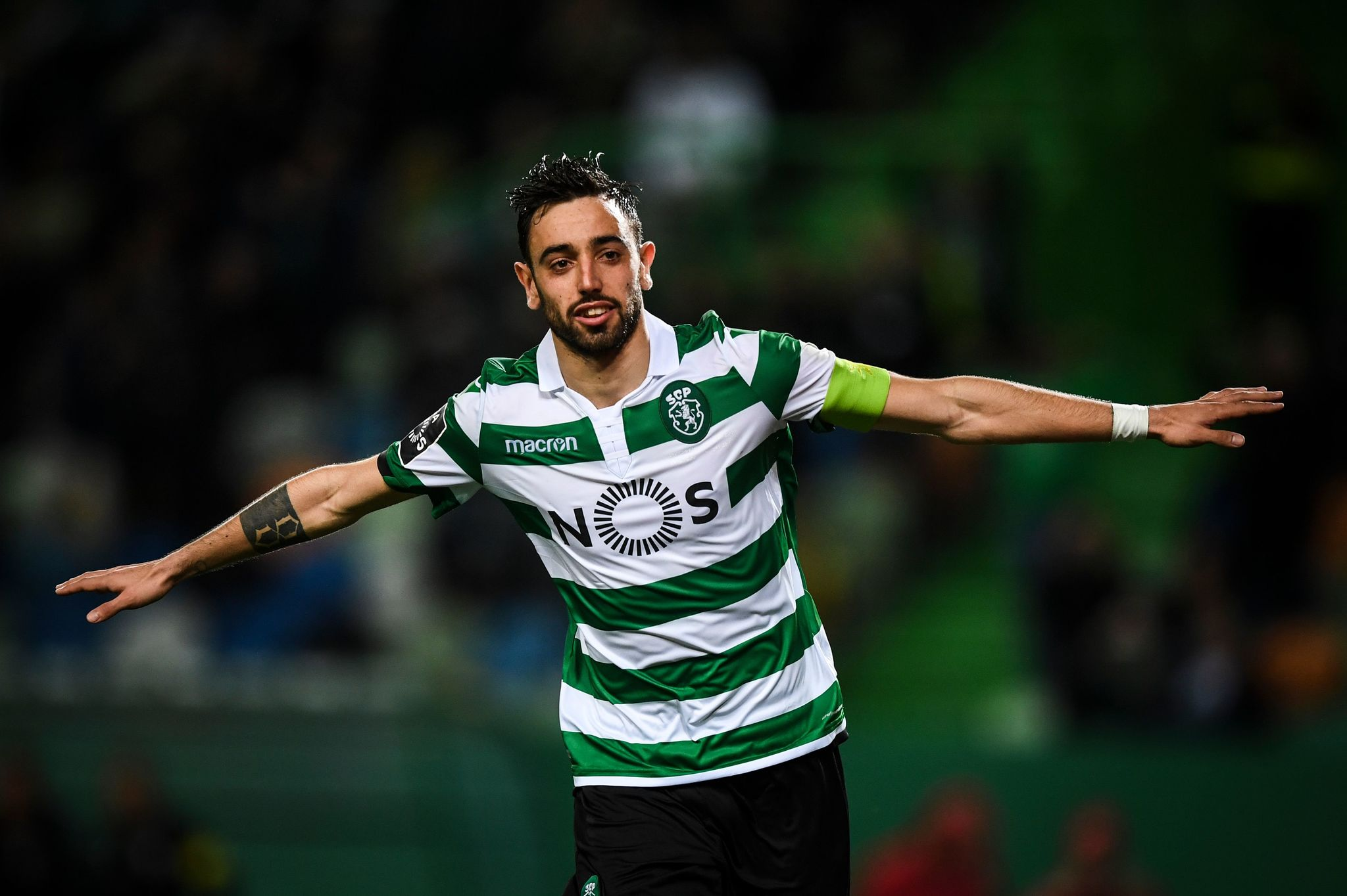 (FILES) In this file photo taken on March 03, 2019 Sportings Portuguese midfielder lt;HIT gt;Bruno lt;/HIT gt; lt;HIT gt;Fernandes lt;/HIT gt; celebrates after scoring a goal during the Portuguese league football match between Sporting CP and Portimonense SC at the Jose Alvalade stadium in Lisbon. - Manchester United have agreed a deal to sign Portuguese international midfielder lt;HIT gt;Bruno lt;/HIT gt; lt;HIT gt;Fernandes lt;/HIT gt; from Sporting Lisbon, the Premier League club announced on January 29, 2020. (Photo by PATRICIA DE MELO MOREIRA / AFP)
