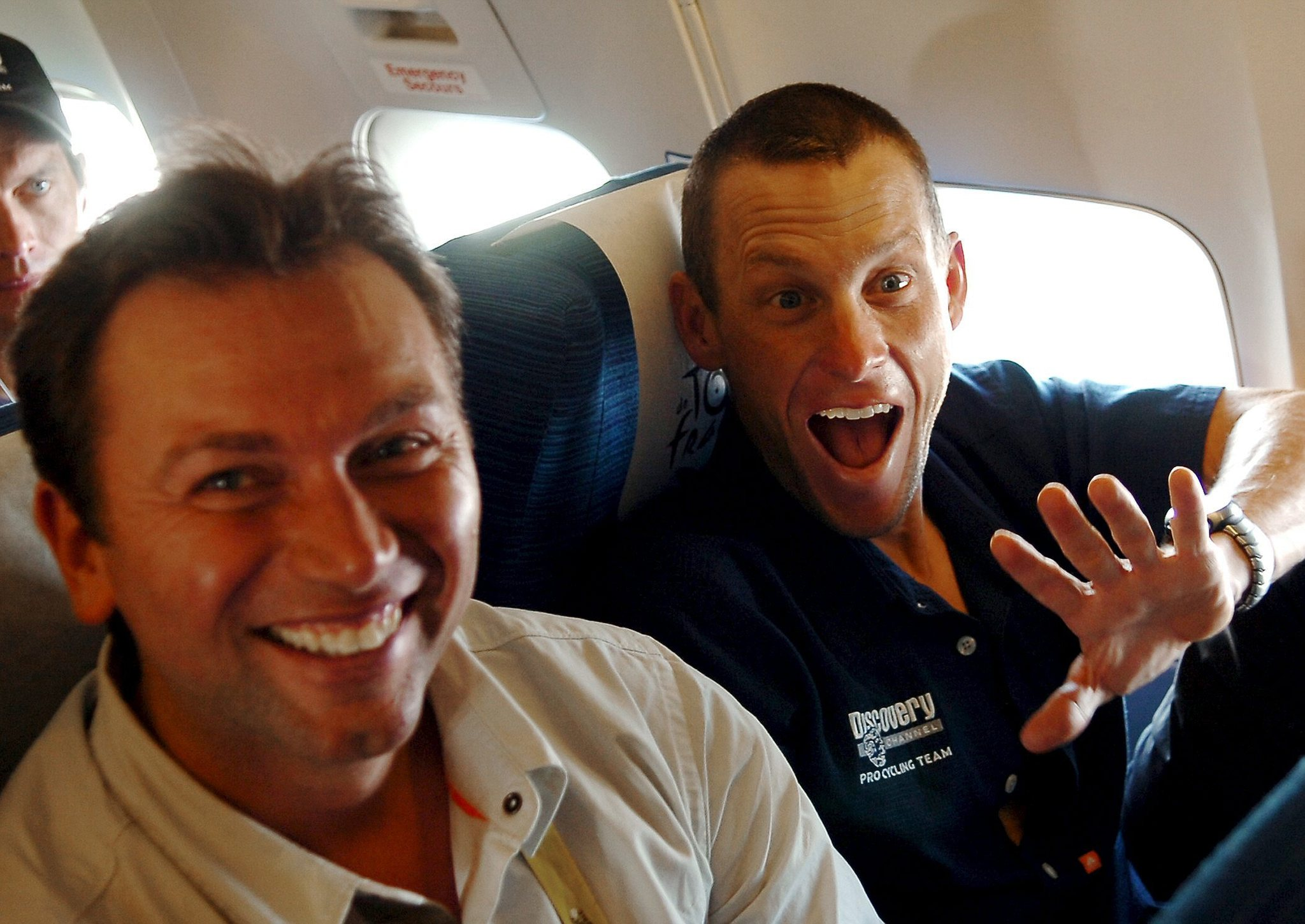 (FILES) In this photo dated on July 10, 2005 US Lance Armstrong (Discovery Channel/USA) and his team Director Johan lt;HIT gt;Bruyneel lt;/HIT gt; (L) joke during the flight to Grenoble from Mulhouse after the ninth stage of the 92nd Tour de France cycling race between Gerardmer and Mulhouse. Armstrongs former boss lt;HIT gt;Bruyneel lt;/HIT gt; leaves RadioShack-Nissan, the team announced on October 12, 2012. AFP PHOTO POOL PASCAL RONDEAU
