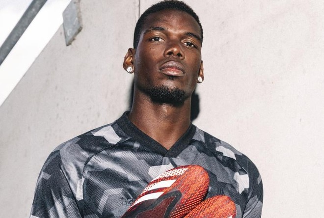 Pogba poses in Adidas boots.